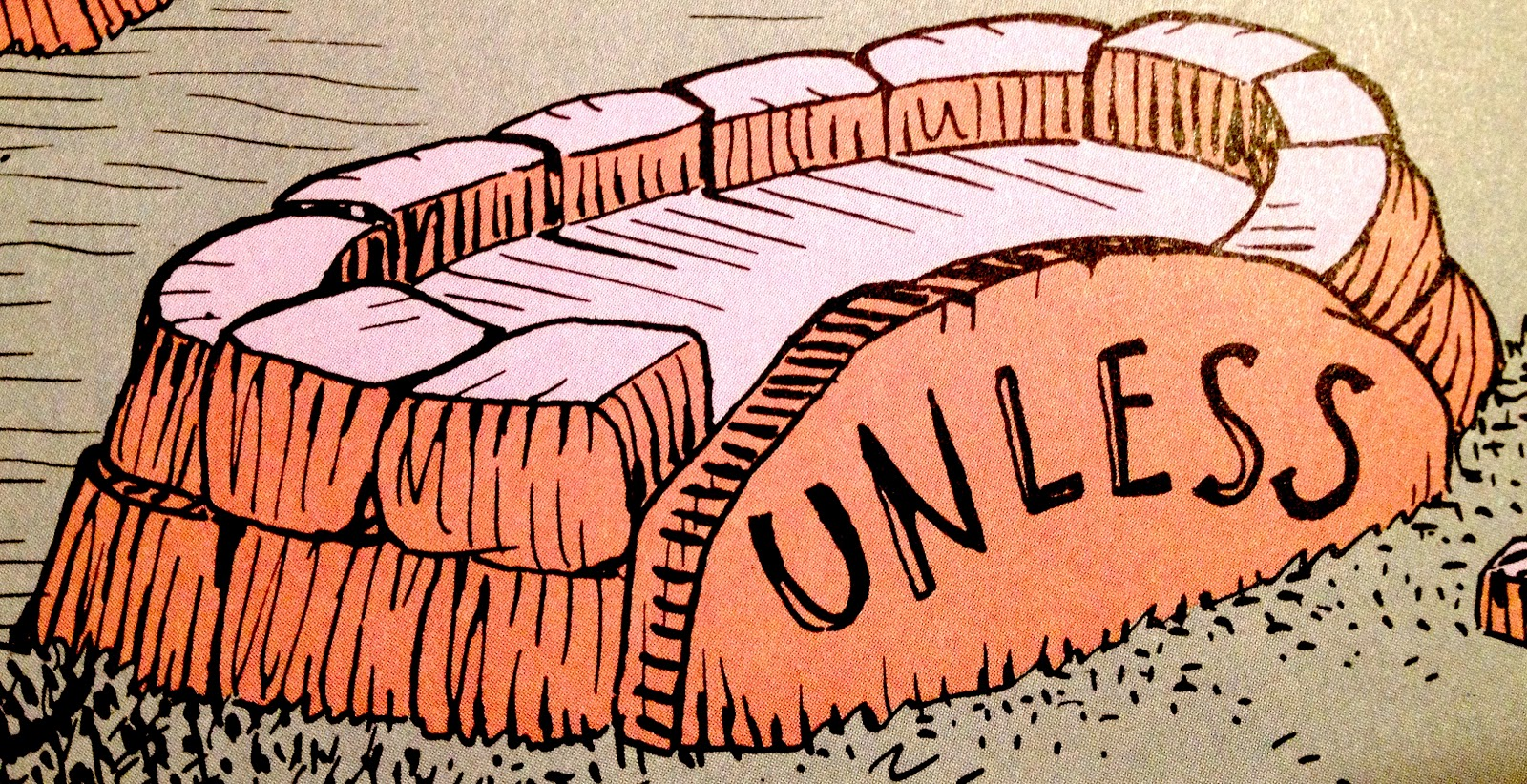 """A circle of stones reads """"UNLESS"""", from Dr. Seuss's """"The Lorax"""""""